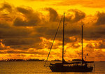 Sailboat anchored in Manihi lagoon at sunrise