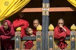 Monks watching the Paro Tsechu (festival), Bhutan