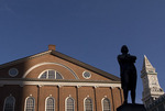 Silhouette of Samuel Adams statue in front of Faneuil Hall (Custom House in the distance), Boston National Historical Park.