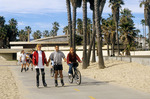 Roller skating and biking on path at Venice beach