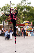 A stilt walker at a street festival in Berlin, Germany