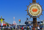 Tourists and Fisherman's Wharf sign at Jefferson and Taylor Streets, San Francisco, California