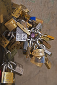 Padlocks locked to Ponte Vecchio (bridge), illegal and considered a negative impact of mass tourism, in Florence, Italy