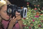 GIRL PHOTOGRAPHER MONARCH BUTTERFLY