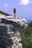 MAN LOOKING THROUGH BINOCULARS AT THE WV NATURE CONSERVANCY BEAR ROCKS NATURE PRESERVE IN THE DOLLY SODS SCENIC AREA