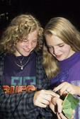 GIRLS LOOKING AT CATALPA SPHINX CATERPILLAR