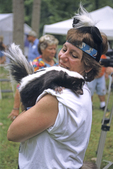 LADY WITH STRIPED SKUNK AT SKUNKFEST IN OHIO