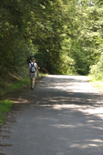 Lady walking along country road