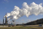 Willow Island Coal Fired Power Plant in WV along the OH River.  Photo shows smoke stacks and cooling towers.