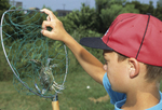 Boy with Atlantic blue crab in net