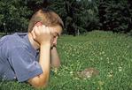 Boy looking at eastern box turtle
