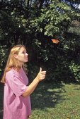 Girl and monarch butterfly