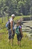 Grandmother and granddaughter looking at beaver dam