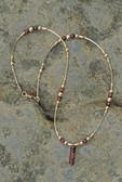 Garnet jewelry made by the caddisfly