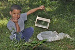 Happy boy with bug box he just built.