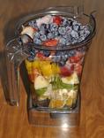 Smoothie with blueberries, strawberries, mango, oranges, apples and kiwi