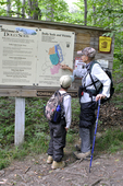 Grandmother and grandson at Rohrbaugh Plains Trail sign in the Dolly Sods Wilderness in WV