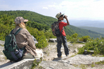 Grandmother and grandson looking at the scenic view along the Allegheny Front in the Dolly Sods Scenic Area in WV
