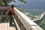 Young boy looking at the scenic view from the Seneca Rocks viewing platform in WV