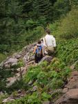 Hikers crossing mountain-side skree field