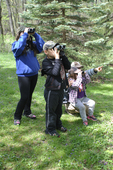 Grandmother and grandkids looking at birds
