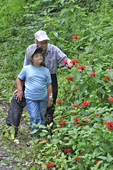 Grandmother and granddaughter looking at Bee Balm flowers