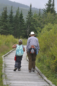 Mother and daughter hiking the boardwalk on the Freeland Trail in the Canaan Valley National Wildlife Refuge