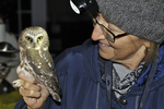 Bird bander holding a recently banded Northern Saw-whet Owl Model Released