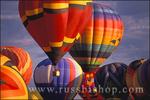 Hot air balloons rising in dawn light at the International Balloon Fiesta