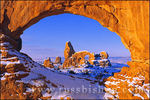 Morning light on North Window framing Turret Arch in winter