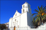 The bell tower and white washed entrance to Mission San Luis Rey de Francia