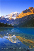 Dawn light on Mount Edith Cavell reflected in Cavell Lake