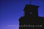San Francisco de Asis Mission Church silhouetted against purple twilight and crescent moon, Rancho de Taos, New Mexico