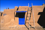 Ladder and adobe house with blue door, South House, Taos Pueblo (World Heritage Site), New Mexico