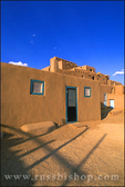 Evening light on the 3-story adobe North House (World Heritage Site), Taos Pueblo, New Mexico