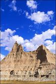 Blue sky and clouds over eroded spires in the badlands near Cedar Pass, Badlands National Park, South Dakota