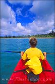 Child kayaking on Hanalei Bay along the north shore, Island of Kauai, Hawaii