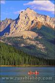 Canoe on Maligne Lake under Mount Sampson, Jasper National Park, Alberta, Canada