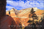 Hiker silhouetted on the Hidden Canyon Trail above Zion Canyon, Zion National Park, Utah