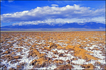 Salt pan (and newly returned Lake Manly) under snow-covered Telescope Peak, Death Valley National Park, California
