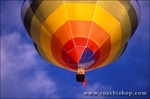 Hot air balloon rising in morning light at the International Balloon Fiesta, Albuquerque, New Mexico