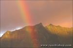 Rainbow over Mount Kaupaopu at sunset from Hanalei, North Shore, Island of Kauai, Hawaii
