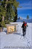 Backcountry skier looking at trail sign at Glacier Point, Yosemite National Park, California