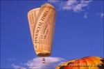 Financial Times hot air balloon rising in dawn light at the International Balloon Fiesta, Albuquerque, New Mexico