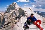 Climber looking out from the summit of Bear Creek Spire, John Muir Wilderness, Sierra Nevada Mountains, California