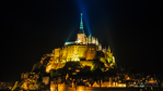 Mont Saint-Michel illuminated at night, Normandy, France