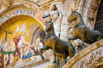 Bronze horses and mosaic above the entrance to Basilica San Marco (Saint Mark's Cathedral), Venice, Veneto, Italy