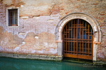 Canal and gate, Venice, Veneto, Italy
