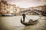 Gondola at the Rialto Bridge on the Grand Canal, Venice, Veneto, Italy