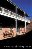 Pioneer artifacts and balcony on the north side of the courtyard inside Winsor Castle (the fort), Pipe Spring National Monument, Arizona